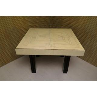 TV 44  Particolare tavolo allungabile con piano in pergamena